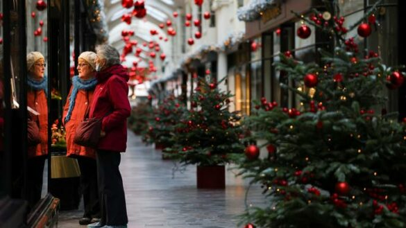 Women are seen at the Burlington Arcade adorned with Christmas decorations, amid the coronavirus disease (COVID-19) outbreak, in London, Britain, November 23, 2020. REUTERS/Henry Nicholls
